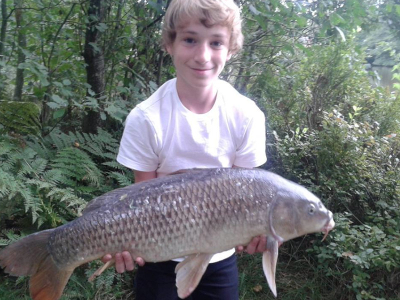 Young Customer Catching a Carp